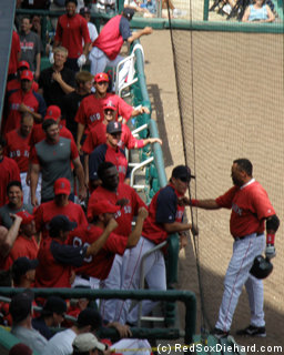 Its all smiles and high-fives for Ino Guerrero as he returns to the dugout.
