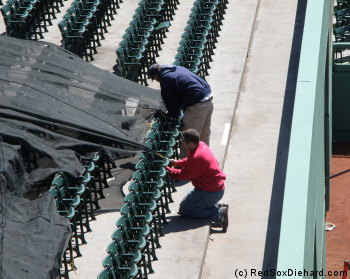 Covering up the seats in center field.