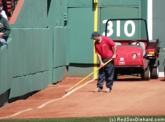 Raking off the left field foul line. I had no idea the warning track was so hilly there!