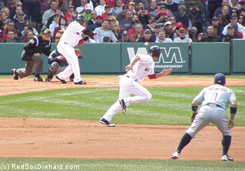 As Big Papi awaits the pitch, Ellsbury takes off for second. Papi struck out, but the throw went into center field, and Jacoby made it to third.