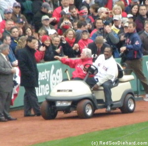 Ted Kennedy and Jim Rice circle the field before throwing out the first pitch.
