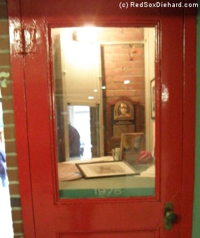 An old Fenway Park ticket booth serves as a display case for memorabilia from the 1975 World Series.