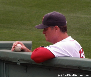Pitching coach John Farrell waits while Tek and Lester get ready.