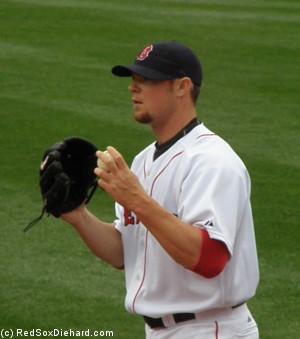 Jon Lester starts long-tossing.