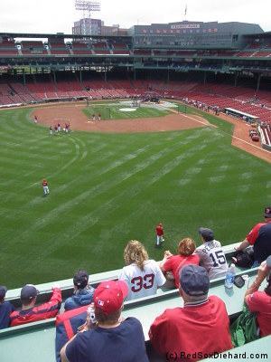 Watching batting practice from the Green Monster.