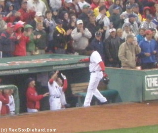 Big Papi is congratulated after his home run.