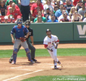 Dustin Pedroia hits a fly into right field.