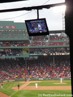 The view from Section 2. There are monitors under the roof, which is cool because they show the NESN feed, including replays of plays that aren't shown at the park. But they also show the commercials, which is pretty tacky.