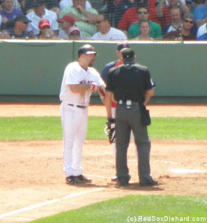 Youk pleads his case after being hit by a pitch.