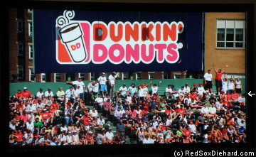 When I got home, I saw that we were on TV when they showed the Dunkin Dugout. My friends and I are the three in red on the far right end of the second row from the top.