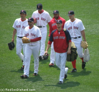 The Red Sox relievers - Takashi Saito, Manny Delcarmen, Hideki Okajima, Ramon Ramirez, Daniel Bard, and Justin Masterson - walk out to the bullpen before the game.