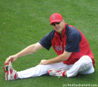 Jonathan Papelbon stretches out before the game.