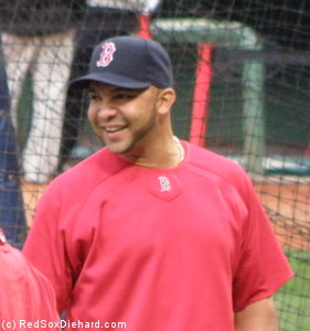 Alex Gonzalez is all smiles the day after his clutch hit won the game for the Red Sox.