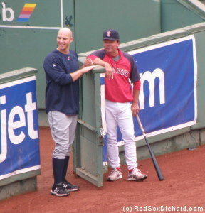 Justin Masterson returns to his old haunt, and watches batting practice with bullpen coach Gary Tuck.
