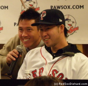Junichi Tazawa answers question with help from his interpreter.