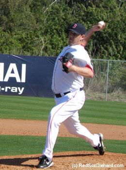 John Lackey throws live batting practice.