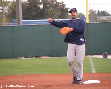 Mike Lowell fields grounders at first base.