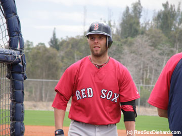 Dustin Pedroia finishes up a round of B.P. against Ramon Ramirez.
