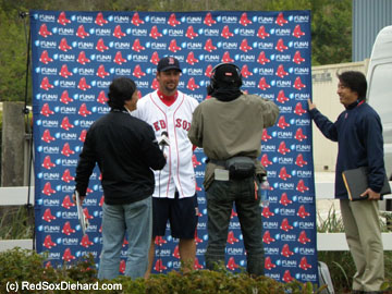 Tim Wakefield does an interview for the Japanese media.  Not sure what he was going for with this half-dressed outfit, though. Who does he think he is, Papelbon?