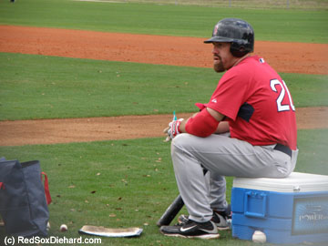 Youk takes a break between rounds of B.P.  He had no problem working upo a sweat despite the cold, rainy weather.