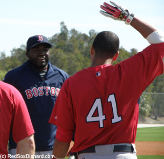 Monday: Victor Martinez greets Big Papi as he joins the group for batting practice.