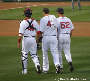 Victor Martinez, John Lackey, and John Farrell walk in from the bullpen before the game.