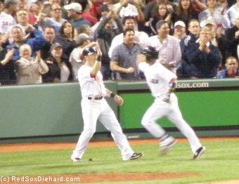 Marco Scutaro congratulates Dustin Pedroia after his game-tying home run.
