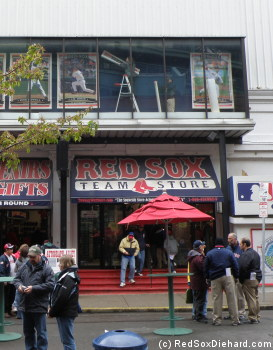 Workers complete hanging the lineup posters in the windows above the souvenir store.