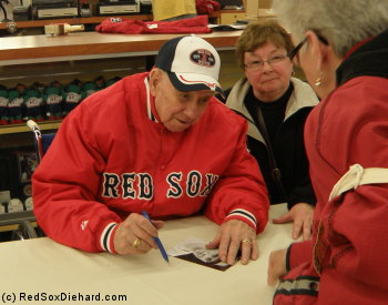 Former Red Sox pitcher Lou Lucier signs autographs in the souvenir store before the game.