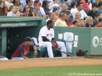 Big Papi waits on the manager's bench for his next at-bat. He certainly did his part to take control of the game!