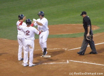 Daniel Nava is congratulated at home plate after his game-tying homer.