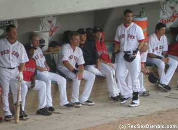 The PawSox dugout included Daniel Nava (left), Tug Hulett (3rd from left), Lars Anderson (4th from left), Mike Lowell (standing), and Gil Velazquez (right).