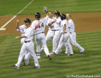 Lars Anderson's teammates congratulate him after his walk-off hit.