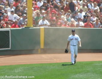 J.D. Drew kicked up a cloud of dust with a sliding catch on the warning track in the second inning.