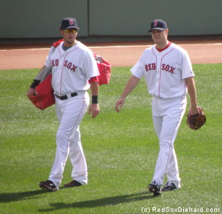 Jarrod Saltalamacchia and Jonathan Papelbon walk out to the bullpen between innings.