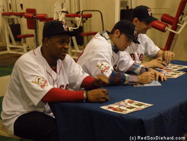 Jason Rice, Stephen Fife, and Robert Coello sign autographs for fans.
