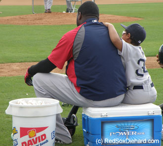 Big Papi and Little Papi take a break during batting practice.
