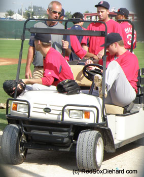 Daniel Bard (left), Dan Wheeler (in back), and Jonathan Papelbon (right) make themselves comforatable while waiting for the next drill to start.