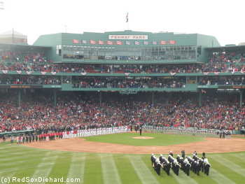 The 2011 Red Sox and Yankees line up for the National Anthem on Opening Day.