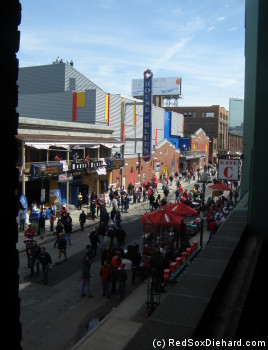 Looking down Lansdowne St. from the stairs to the Green Monster. This shot is from Opening Day, and is probably the exact opposite of how the Fenway Park area looked on today's cold, rainy night.
