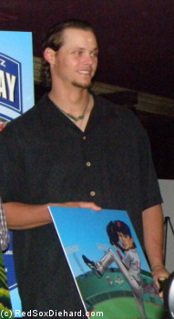 Clay Buchholz poses with a picture advertising his ChardonClay, which benefits the Jimmy Fund.