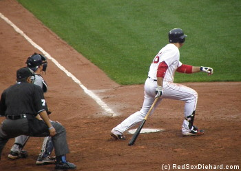 Gonzo heads for first after one of his four hits.