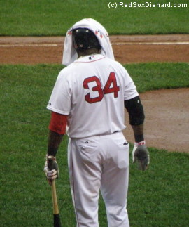 Big Papi tries to stay dry while waiting on deck in the seventh inning.