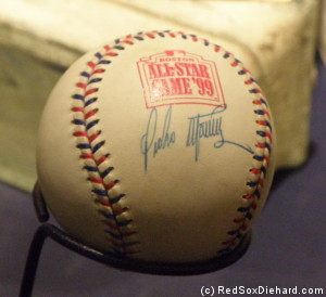 A ball from the classic 1999 All-Star game, autographed by MVP Pedro Martinez, is on display.