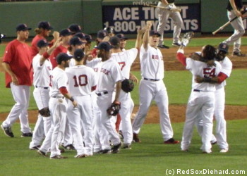 Darnell McDonald is congratulated after his game-saving throw. Big Papi and Jonathan Papelbon are particularly impressed.