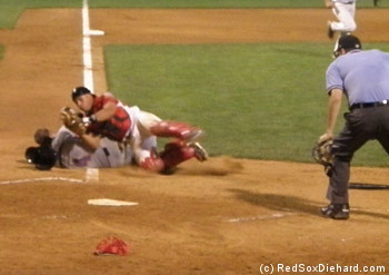 Jayson Hernandez tags out Kyle Hoppy in a collision in front of home plate to end the top of the eleventh.