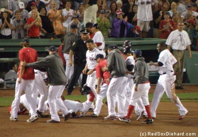 "Jacoby Ellsbury is tackled - I mean ""congratulated"" - by his teammates after his walkoff hit."