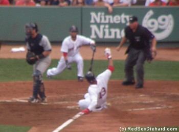 I don't care if it's out of focus, I love this picture of Crawford sliding in safely with the Red Sox' first run.