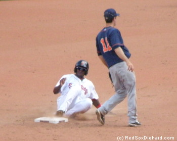 Oscar Tejeda slides into second base. I was happy to see him in the game today, because he's a player I knew from Spring Training but he hadn't played in the Sea Dogs game I went to last month.