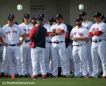 New manager Bobby Valentine instructs the players before the workout.
